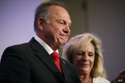 Former Alabama Chief Justice and U.S. Senate candidate Roy Moore speaks at a news conference with his wife Kayla Moore, in Birmingham, Ala., Nov. 16, 2017.